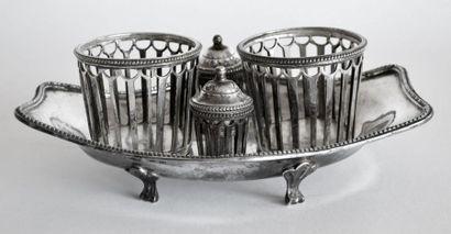 PORTE-HUILIER en métal plaqué de forme navette sur quatre pieds à enroulements,...