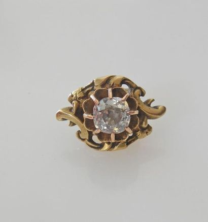 *COULANT en or jaune serti d'un diamant T.A....