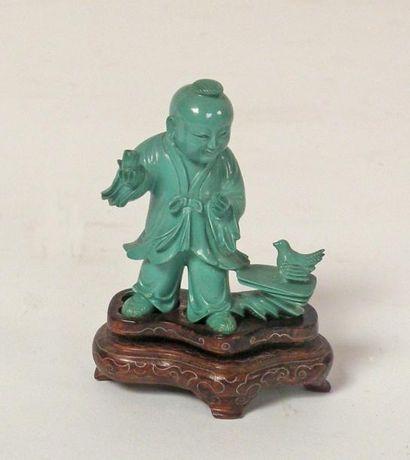 SUJET en turquoise sculptée figurant un enfant...