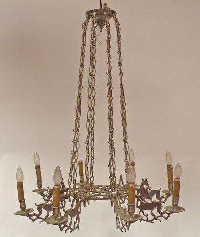 LUSTRE en métal découpé à décor de cervidés....