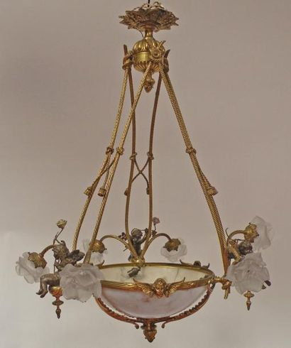 LUSTRE en bronze doré et bronze à patine brune, la structure à l'imitation d'un...