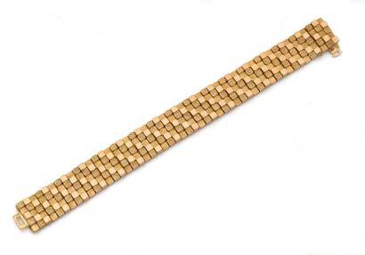 BRACELET ruban articulé en or jaune, à motifs...