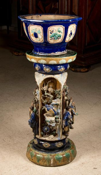 CHINA. Planter and its support in glazed ceramic, decorated with relief characters....