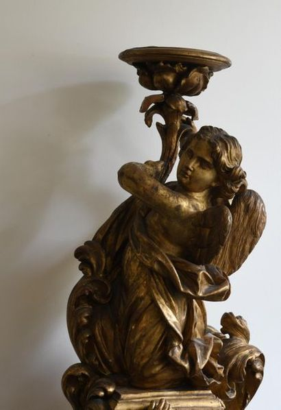 *French school of the 18th century.  Torch-bearing angel, in a palmette setting....