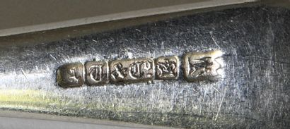 Four silver plated metal forks with engraved decoration. Foreign work (Germany?)....