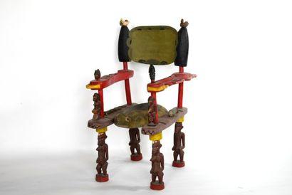 COTE D'IVOIRE  Grande chaise en bois sculpté...