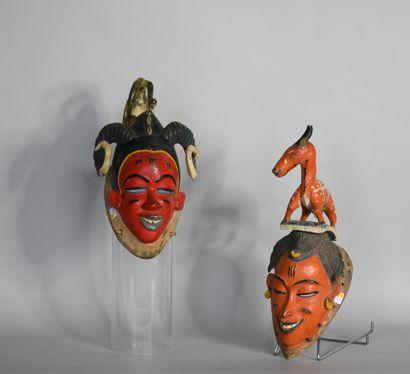 COTE D'IVOIRE  Paire de masques en bois sculpté...