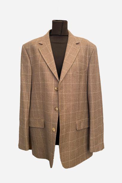 COURREGES. Veste de tailleur en laine marron...
