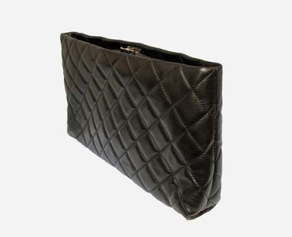 CHANEL. Black quilted lambskin leather clutch....
