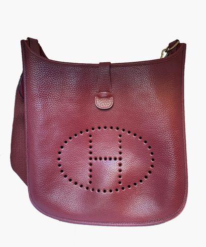 HERMES. Bag Evelyne 32 cm in burgundy leather....
