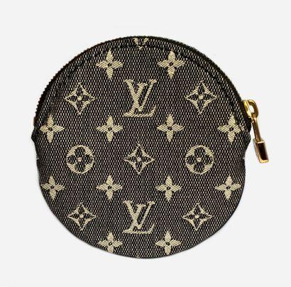 LOUIS VUITTON. Round coin purse in black...
