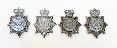 Réunion de 4 plaques de casque de policier...