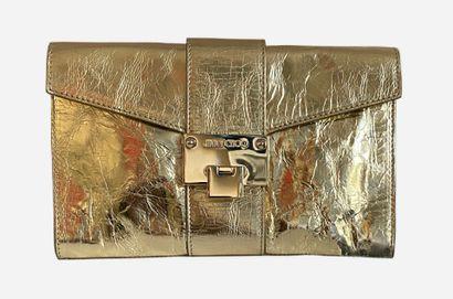 JIMMY CHOO. Pochette en cuir effet métallisé...