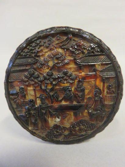 Round Chinese tortoiseshell box with relief...
