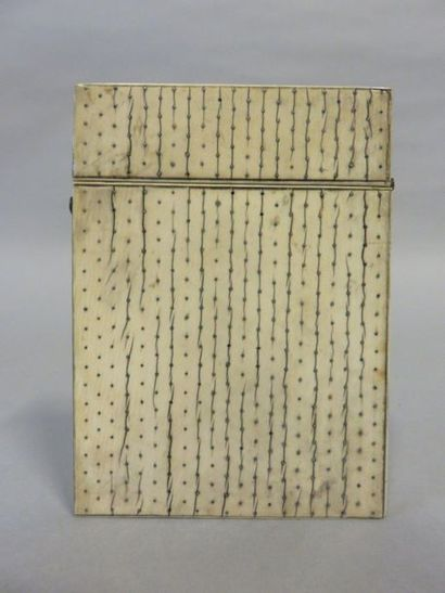 Ivory card case inlaid with silver tips....