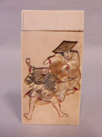 Ivory case in round polychrome hump, with...