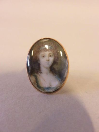 Gold ring set with a miniature of a woman's...