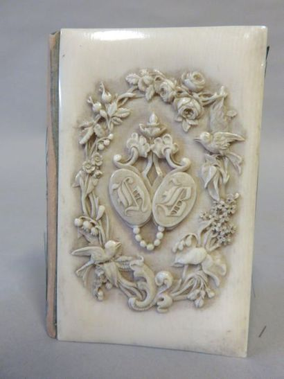 Round ivory bumpy ball book case with monograms...