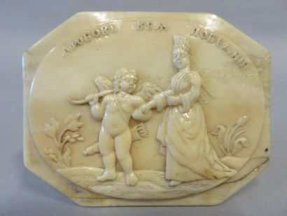 Octagonal ivory box with a round humped lid...