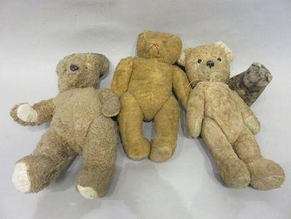Three teddy bears and a teddy cat.