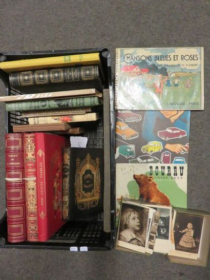 Children's book lever and postcards on the...