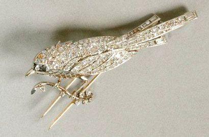 Broche en platine, or gris et diamants (...