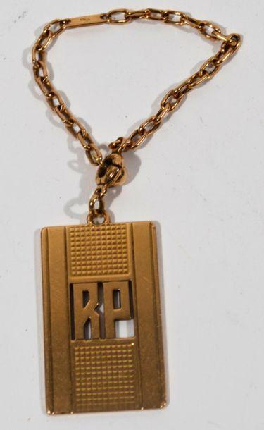 Porte-clés en or jaune 18 K (750/oo) chiffrée...