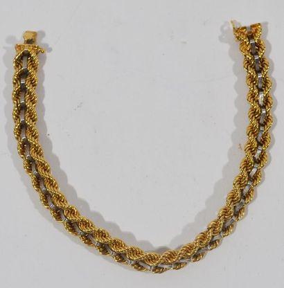 Bracelet en or de deux tons 18 K (750/oo)...