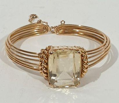 Bracelet rigide en or jaune 18 K (750/oo)...