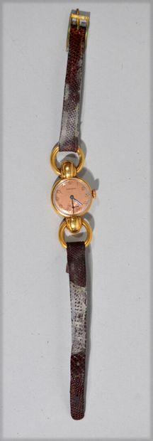 LONGINES - Ladies' wristwatch in 18 K (750/oo) yellow gold, round dial with copper...