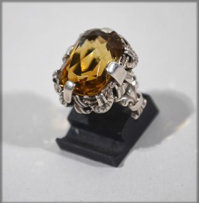 Richly decorated silver ring set with a citrine...
