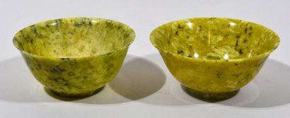 China, 20th century  Green jadeite bowl meeting...