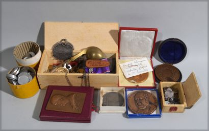 Wooden box containing religious medals in...
