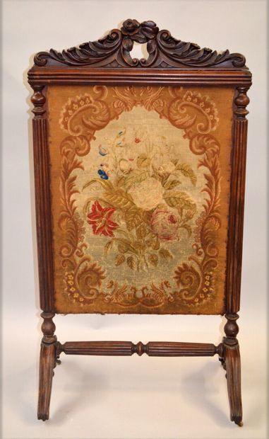 FIREPLACE in carved wood, the pediment with flower decoration, fluted uprights and...