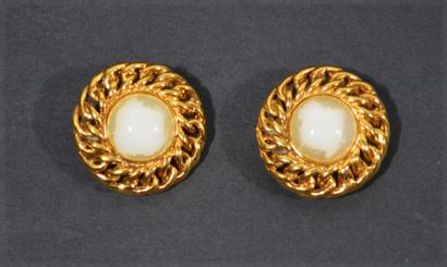 CHANEL - Pair of gold metal ear clips centered...