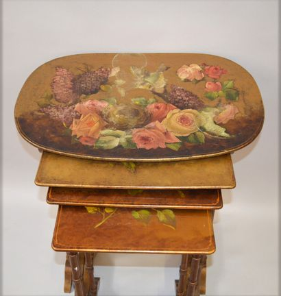 Suite of four gilded and lacquered wooden nesting tables decorated with a chickadee...