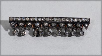 Silver plated brooch holding rhinestones...
