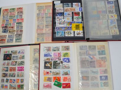Lot de 4 classeurs de timbres francais oblitéres...