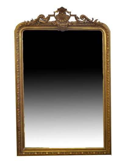 Stuccoed and gilded wood mantel mirror decorated...