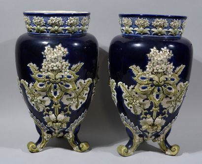 A PAIR OF VASES in barbotine with relief...
