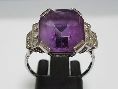 Platinum ring surmounted by an emerald cut...