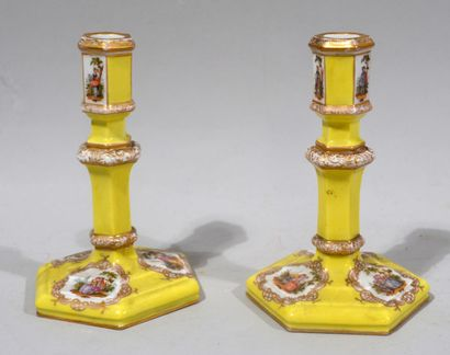 PAIR OF FLAMBEAUX in yellow porcelain with...