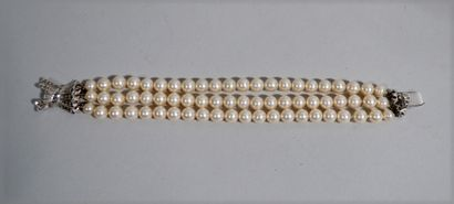 Three-row bracelet of cultured pearls with...