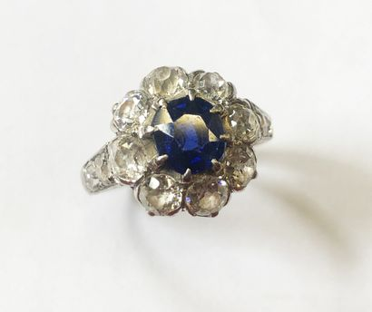 POMPADOUR RING in 18K white gold (750/1000th) set with a central oval sapphire of...