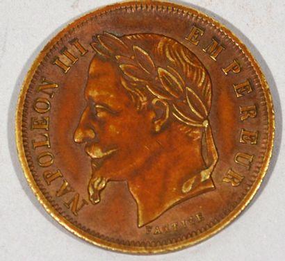 Une pièce de 50 Francs Napoléon III (factice)...