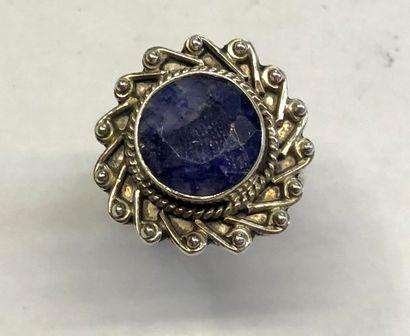 BAGUE de forme soleil en argent 925/1000e sertie d'une pierre bleue.  TDD : 61....