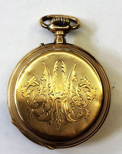 MONTRE DE GOUSSET en or 18K (750/1000) à décor finement ciselé du monogramme feuillagé...