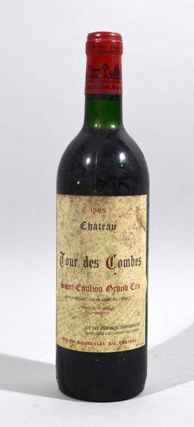 Une bouteille de CHATEAU TOUR DES COMBES...