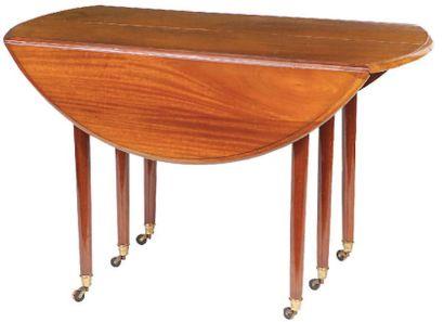 TABLE à volets à allonges en acajou et placage...