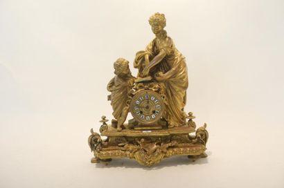 Pendule de cheminée d'époque Napoléon III ornée de figures allégoriques (L'Étude),...